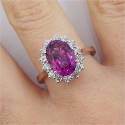 18ct white gold oval pink sapphire and diamond cluster ring, pink sapphire approx 3.30 carat, total diamond weight approx 0.50 carat