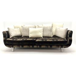 Grande four seat sofa upholstered in patterned fabric with contrasting scatter cushions