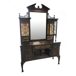 Late Victorian oak mirror back side cabinet, sloped arched pediment with dentil detail, the large rectangular mirror with bevelled edge, two astragal glazed display cabinets to each side, lower section fitted with drawer and cupboards, panelled doors with floral and ribbon carved mounts, blind fret work throughout, foliage carved supports, W154cm, H240cm, D51cm