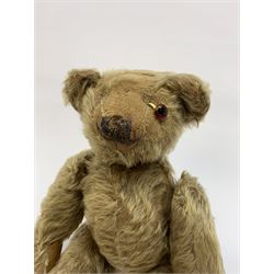Rare early 20th century teddy bear c1920, possibly Chiltern/Einco or Harwin, mohair covered with wood wool filled humped back body with jointed limbs, cotton twill paw pads and vertically stitched nose with unusual W-shaped stitched mouth H15