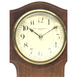 Art Nouveau inlaid mahogany serpentine top mantel timepiece, the  convex white enamel Arabic dial signed 'Manoah Rhodes & Sons. Ltd. Bradford', with brass bezel and key wind movement, on plinth base with brass ball feet, H26cm
