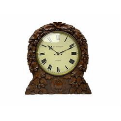 """A mid-19th century eight-day Oak cased twin Fusee wall clock with integral support bracket, movement striking the hours on a coiled gong, thirteen-inch painted dial with roman numerals and minute track, blued steel Fleur de Lys hands, dial inscribed """" Jos Penlington, Liverpool"""", lockable brass bezel with flat glass, rectangular shouldered four pillar movement plates, rack striking and recoil escapement, movement pinned to the dial via a false plate, rectangular case and bracket on carved corbel supports, profusely carved dial surround with representations of oak leaves and  acorns upon a tooled background, two movement doors with sound frets and one pendulum adjustment door. With Pendulum.  The Pennington's were a prolific family of clockmakers working in Liverpool from 1818 until the turn of the 20th century."""