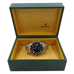 Rolex Oyster Perpetual Date Submariner 2001 stainless steel automatic wristwatch, model No.16610, serial No.K644609, boxed with papers