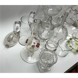 A group of mostly 19th century glassware, to include smoke bell with folded rim, cut glass vase, sugar bowl with part slice cut bowl and knopped stem, pedestal bowl with etched border to rim, documentary marriage jug engraved with date 1899, two cut glass sweet meat jar and covers, vase of squat waisted form with green trailed decoration, etc.