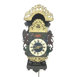 Early 19th century Dutch lantern clock with wall bracket, pierced and cast gilt metal decorative mounts, the dial with Roman and Arabic numerals painted with flowers, painted wall mount with urn and lion pediment, the five pillar movement with verge escapement striking on bell, H76cm