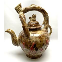 A large novelty Chinese ceramic teapot, the body decorated with characters upon a mottled brown ground, with naturalistically modelled handle and domed cover with temple lion type finial, H62cm.