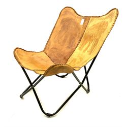 Elephant embossed sling chair upholstered in brown leather