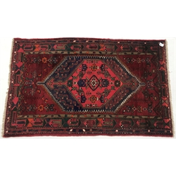 Afghan hand knotted red ground rug, diamond centre with geometric pattern, 195cm x 122cm
