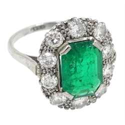 Platinum emerald cut emerald and diamond cluster ring, stamped Plat