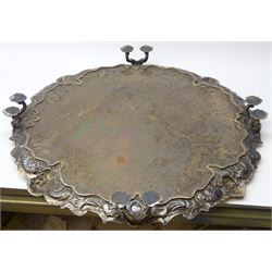 Large and impressive early 20th century Georgian style silver salver, the cast C scroll border detailed with four masks with fruiting vines, flowers and wheat ears, upon four twin scrolling feet with flower head pads, hallmarked Elkington & Co Ltd, Birmingham 1931, D55.5cm, weight 157.66 ozt (4904 grams), with oak stand