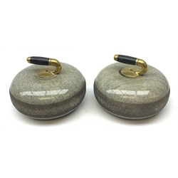 Pair of early 20th century Curling Stones, the bronze handles with ebonised grips, D30cm
