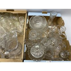 A large group of Victorian and later clear glassware, to include various cut glass, drinking glasses of various form, jugs, vases, bowls, etc.