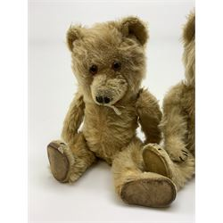 Chiltern Ting-a-Ling teddy bear c1950s with blond mohair body, swivel jointed head with glass eyes and vertically stitched nose and mouth, jointed limbs with velvet pads and card lined feet and internal chimes H14