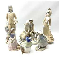 A group of six Spanish porcelain figures, including Nao a girl with a cake and puppy, H20cm, Nadal girl with flowers, H22cm etc.