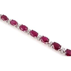 18ct white gold oval ruby and diamond bracelet, hallmarked, total ruby weight 11.00 carat, total diamond weight approx 1.20 carat