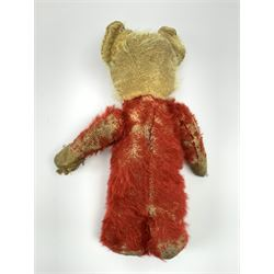 Chad Valley Rainbow Tubby or clown bear c1930s with wood wool filled red mohair body, applied glass eyes and vertically stitched nose and mouth, bears original red stitched Chad Valley Hygienic Toys label under left foot H10