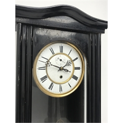 Early 20th century ebonised Vienna type wall clock, shaped pediment over arch glazed door, circular Roman dial with subsidiary seconds dial, single train driven movement stamped 'Schultz Marke, 104340', H104cm
