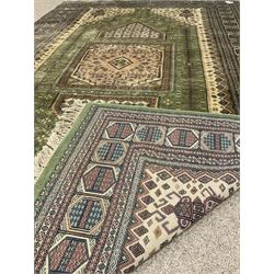 Persian design green and beige ground carpet, the field decorated with square medallion and repeating stylised flower heads, highly patterned multi-band border