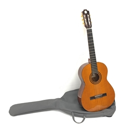 Admira Spain Virtuoso acoustic guitar , bears label, 101cm overall, in soft carrying case; together with a Seiko quartz guitar tuner (2)