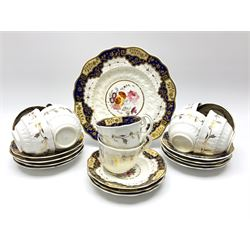 19th century teawares, comprising eight tea cups, two further cups, eleven saucers and a cake plate, decorated with central floral spray, within a moulded border and blue border to rim detailed in gilt.