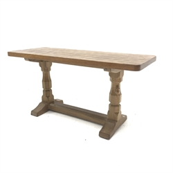 'Mouseman' adzed Yorkshire oak coffee table, rectangular top raised on octagonal supports with sledge feet, united by floor stretcher, by Robert Thompson of Kilburn, 91cm x 38cm, H45cm