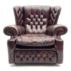 Georgian style wing back armchair, upholstered in deeply buttoned burgundy leather