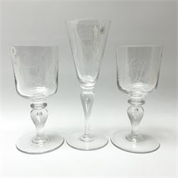 Three Whitefriars Royal Commemorative glasses, comprising two examples with bucket bowls etched with Royal ciphers and dates, upon baluster stems with internal tears and circular feet, one marked beneath W T Wilson no1080, the other G Baxter no 86; and a third example with funnel bowl also etched with Royal cipher and date, upon a baluster stem with internal tear and circular foot, marked beneath G Baxter No 218, H23.5cm.