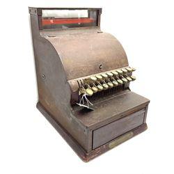 An Antique cash register, made by The National Cash register Co, Ltd. London, H43.