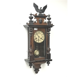Late 19th century walnut cased Vienna style wall clock, with eagle and final pediment, twin train 'Junghans' movement striking on coil, H82cm