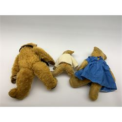 Three English teddy bears comprising 1930s Merrythought with kapok filled bright golden mohair body, swivel jointed head with glass eyes and vertically stitched nose and mouth and jointed limbs with felt paw pads H18