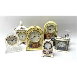 A group of seven mantle clocks, to include a Tupton ware example decorated with poppies, an Aynsley Orchard Gold example, a Masons Madalay pattern example, a Royal Albert Old Country Roses pattern example, a Galway Crystal example, etc.
