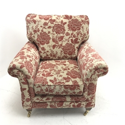 Alstons armchair, upholstered in a red and beige Henna floral fabric, W97cm