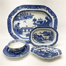 A late 18th century Caughley Salopian dessert dish decorated in the Caughley Willow pattern with a willow type landscape containing two figures in conversation within a white reserve, with printed marks verso, L26.5cm, together with a later dish decorated in a similar pattern, D23.5cm, a 19th century blue and white platter decorated in the Long Bridge pattern, L51.5cm, and two further pieces of blue and white.