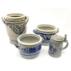 Three Westerwald stoneware twin handled pots, with scrolling decoration in cobalt blue, largest example H24cm, together with a Marzi & Remi Stein. (4).