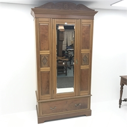 Edwardian bedroom suite comprising of mahogany raised mirror back dressing table, four drawers, turned supports joined by undertier (W107cm, H155cm, D54cm) a wardrobe with mirrored door above single drawer, shaped plinth base (W117cm, H207cm, D56cm) and chair (3)