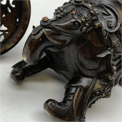 Chinese bronze 'Elephant' censer and cover, of tripod form cast with elephant handles and feet, the trappings inlaid with hardstone cabochons, the pierced domed cover set with a sleeping elephant supporting a basket filled with precious objects, with impressed Ming type seal to base, H26.5cm
