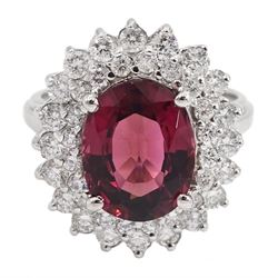 White gold oval tourmaline and round brilliant cut diamond cluster ring, stamped 14K, total diamond weight approx 1.70 carat, tourmaline approx 6.00 carat