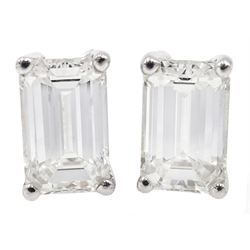 Pair of 18ct white gold emerald cut diamond stud earrings, hallmarked, total diamond weight 1.80 carat