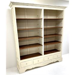 Laura Ashley Bramley range French style cream painted open bookcase, eight adjustable shelves above four drawers, shaped plinth base