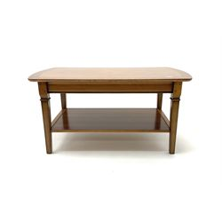 Rectangular walnut coffee table, cross banded top, square tapering supports joined by under tier
