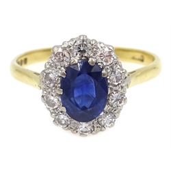 Sapphire and diamond cluster ring, hallmarked 18ct