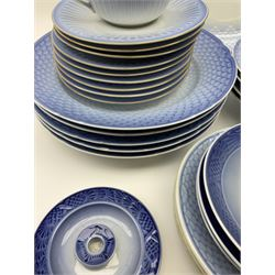 A group of Royal Copenhagen and Bing and Grondahl tea and dinner wares, in differing patterns, to include part tea set with six tea cups and nine saucers, etc,