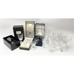 A collection of modern Commemorative and souvenir drinking glasses, to include three boxes examples, and examples by Webb, Stuart, and Caithness, a number of Royal Commemorative examples, and examples with air twist and baluster stems.