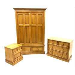 Polished pine bedroom set - double wardrobe fitted with two drawers (W135cm, H200cm, D62cm), chest fitted with two short and two long drawers (W92cm, H76cm, D46cm), bedside cabinet fitted with drawer and cupboard (W52cm, H61cm, D43cm)