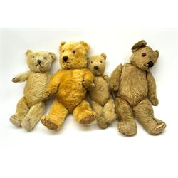 Four English teddy bears 1930s-50s including Chiltern type with swivel jointed head, glass eyes, vertically stitched nose and mouth and jointed limbs H17