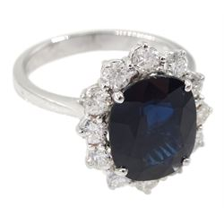 18ct white gold oval sapphire and diamond cluster ring, hallmarked, sapphire approx 4.30 carat, total diamond weight approx 1.05 carat