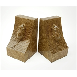 'Mouseman' pair adzed oak bookends by Robert Thompson of Kilburn, carved mouse signature to each end, H16cm