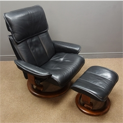 Ekornes Stressless swivel reclining armchair with matching footstool upholstered in black leather
