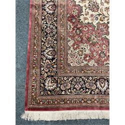 Finely knotted Persian Qom silk rug, overall pink ground with ivory field, the field with central cusped medallion profusely decorated with interlacing foliate and stylised flower heads, multiple band boarder, the main band decorated with a series of stylised motifs and trailing foliage, the outer guard with signature panel