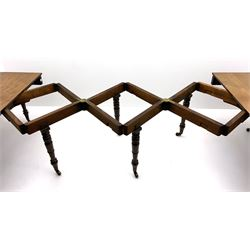 George III mahogany extending dining table, pull out concertina action, raised on eight collar turned supports with brass cups and castors